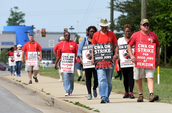 In their strike against Verizon Wireless, workers picket on Hull Street.