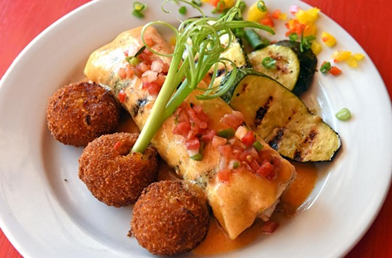 The enchilada Acapulco is composed of shrimp, crabcakes and carmelized onions in a flour tortilla.