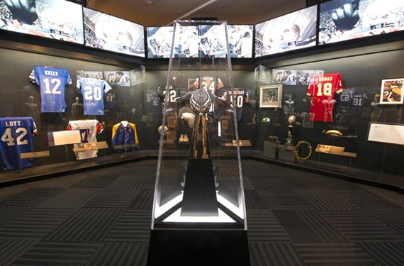 "A Vince Lombardi Super Bowl trophy sits surrounded by the jerseys of former National Football League greats in the new exhibit ""Gridiron Glory: the Best of the Pro Football Hall of Fame"" at the Virginia Historical Society."