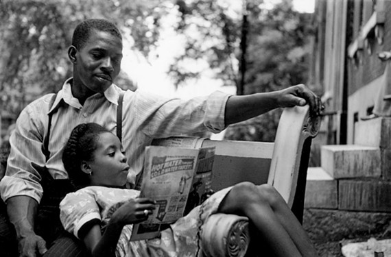 This image shows everyday life for African-Americans in St. Louis, Missouri, in 1950, shot by former Life magazine photographer Gordon Parks.