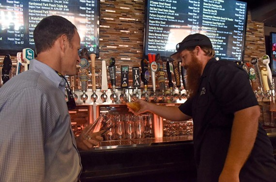 Stone Brewing Co.'s Peter Wiens pours the first glass of Richmond-made and distributed beer at its roll-out celebration at the Southern Railway Taphouse.