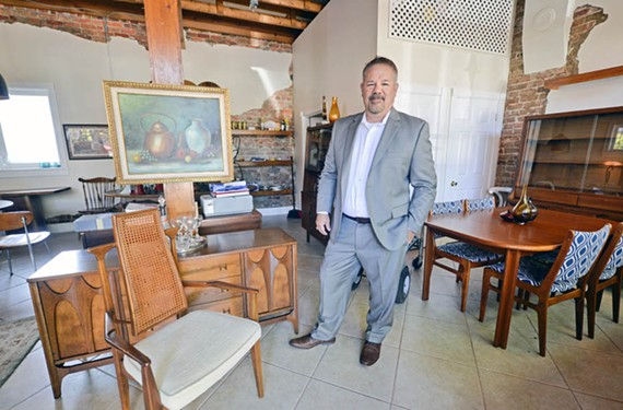 Allan Martin stands  in his furniture showroom on Davis Avenue in the Fan.