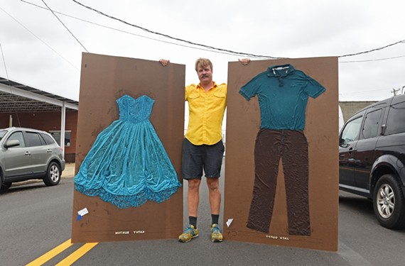 Art on Wheels' Kevin Orlosky stands between two panels that will help honor the lives of cancer victims as part of a record-breaking collaboration this weekend.