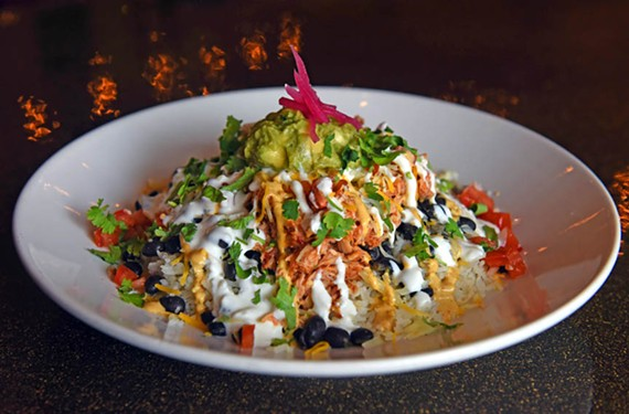 You'll find spicy shredded chicken, guacamole, black beans and cheddar, all dressed with a bonus of avocado ranch in Boka's Tijuana chicken tinga.
