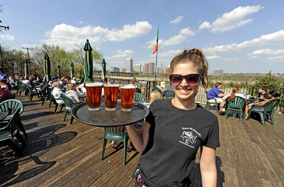Alexis Rinehardt serves beer on the deck at Legend in Manchester, a long-running favorite for its deck, view and local craft brew.