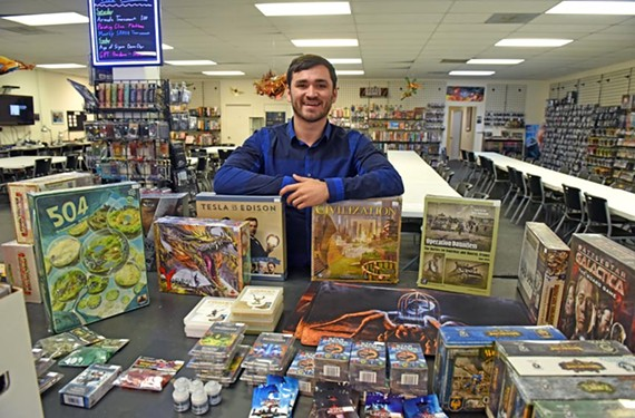 Board game designer Tim Armstrong stands at Battlegrounds in Midlothian, site of the next RVA Game Design event, the second annual Unpub.