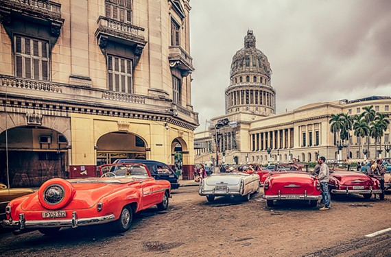 Taxis line the famous Prado in Havana that divides the central and old quarters of the city. The photo, taken by Joe Ring, will be part of a new show at Art Works.