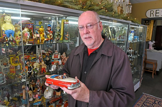 Collector Richard Brezner stands before some of his classic toys at West End Antiques Mall. Brezner started out DJing in New York and steadily has built an impressive collection over the years.