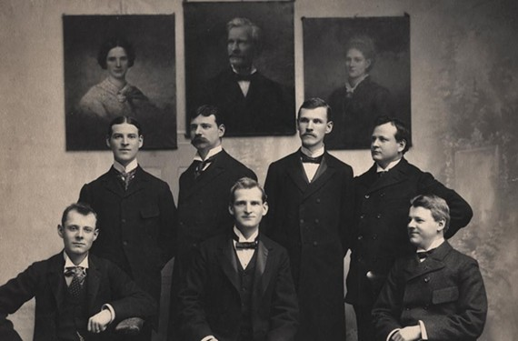 In 1905, the seven sons of Mann S. Valentine posed with portraits of Mann S. Valentine II, his first wife and daughter, Mary Valentine Mosely, hanging in the background.