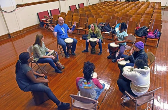 Rachel Yeatts and her husband Scott teach a group of sixth-grade kids at Albert Hill Middle School how to think critically using drum rhythms.