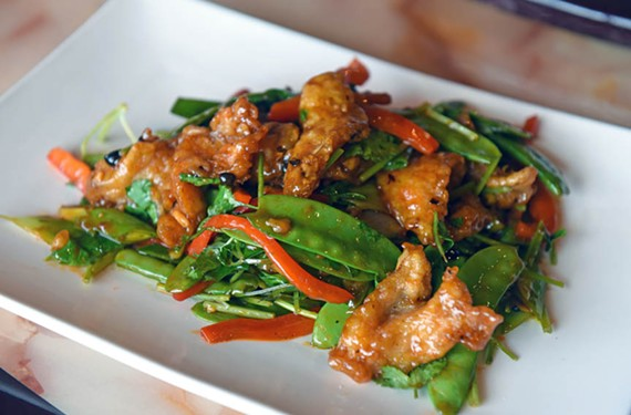 Hunan fish at Peter Chang is a gateway dish into the celebrity chef's cuisine: spicy without being overpowering and crisp on the outside with a moist, flavorful interior.