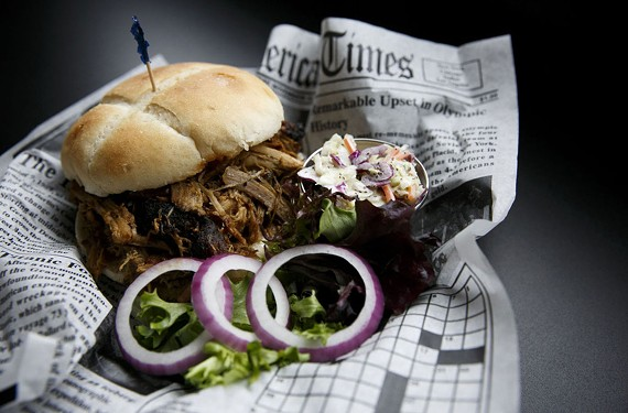 The pulled pork sandwich features a surprisingly peppery kick and comes with a side of homemade coleslaw at Twisted Pig Ale and Smokehouse in Portsmouth, Va.