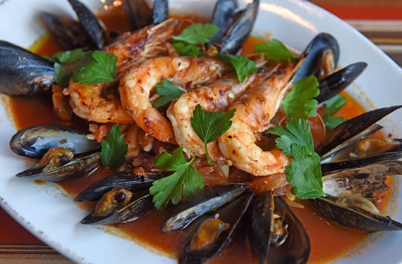 Nota Bene's cioppino arrives piled high with mussels, prawns, octopus and crab. The Shockoe Bottom eatery is Style Weekly's 2017 Restaurant of the Year.