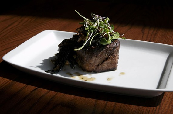 A pan-seared filet with wild mushrooms and local micro greens prepared by Chef Eric Nelson at Chops Seafood and Steak in Virginia Beach.