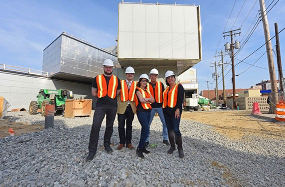 Adam Hall, Jamie Gregory, Neil Gregory, Bobby Spivey and Roberta Oster Sachs pose at the under-construction Institute for Contemporary Art.
