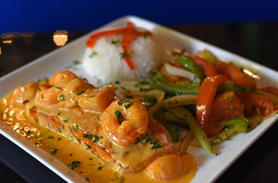 Seasoned shrimp and scallops top the salmon Mexicano at Alero Mexican Restaurant.