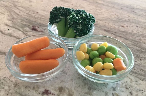 Warmed-up fruit chews, green icing and green sprinkles can be used to make faux veggies for an April Fools' Day surprise.