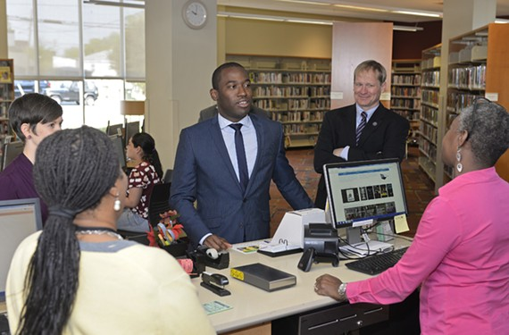 Mayor Levar Stoney visits the East End branch with Richmond Public Library director Scott Firestine on Thursday as part of National Library Week.