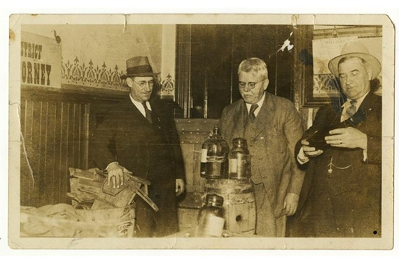 Richmond officials examine seized booze in 1930.