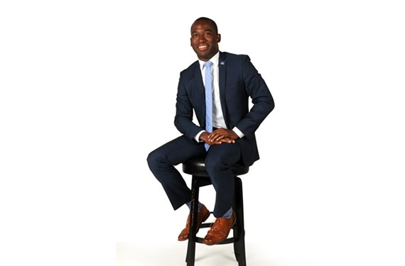 Mayor Levar Stoney poses in a dapper, slim-cut suit.
