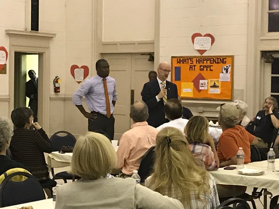 Mayor Levar Stoney and City Council vice president Chris Hilbert listen to Ginter Park and Sherwood Park resident concerns about the Union Presbyterian Seminary's development of the Westwood Tract on Wednesday night.