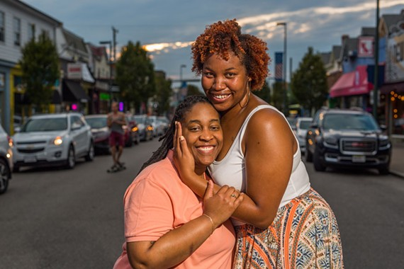 "Monet and Nandi Alexander-Hinton of Richmond pose in Carytown. They describe their family as ""insane"" with strong personalities who can bump heads, but at the end of the day, they love each other unconditionally."