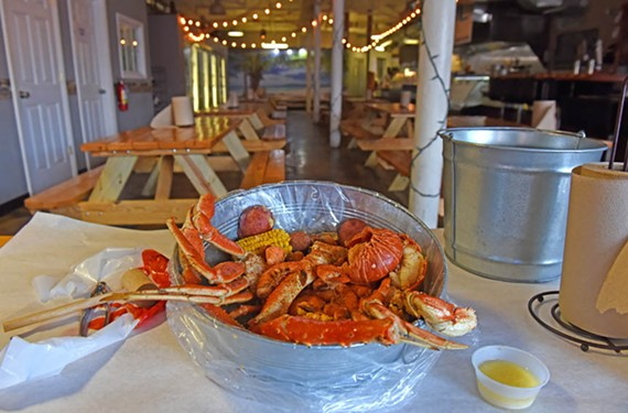 You'll find an abundance of seafood in Sauce and Toss' Sharks Bucket No. 5, including a lobster tail, shrimp and king and Dungeness crab legs.