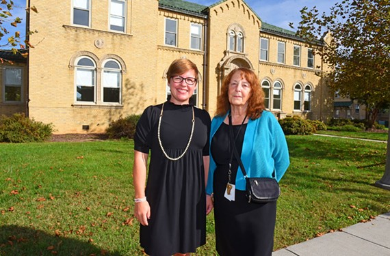 Honesty Liller, chief executive of the McShin Foundation, and Diana Morris, St. Joseph's Villa's senior director of children's education services, in front of the McShin Academy building on the St. Joseph's Villa campus on Brook Road.