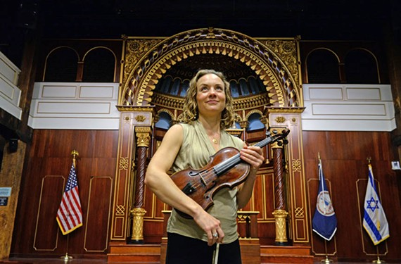 Jocelyn Vorenberg, a violinist with the Richmond Symphony since 2003, holds a special instrument, nicknamed Nettie, that once belonged to Jewish musician Natascha Wilczynski, who was captured and killed at Auschwitz.