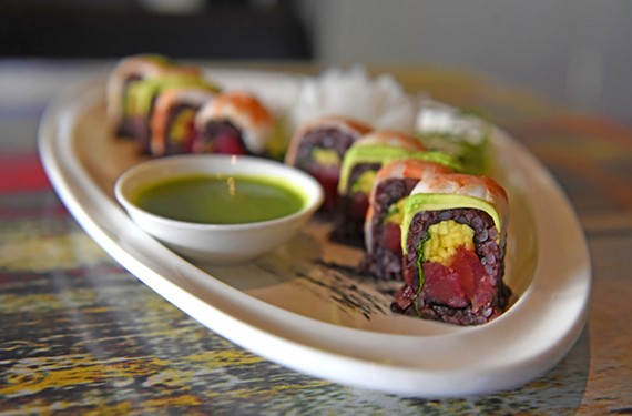 The satisfying Wonder Woman roll boasts black rice wrapped around tuna, mango and cilantro, topped with shrimp and avocado.