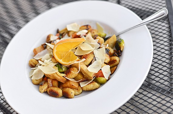 The toasted gnocchi at Savory Grain also include a number of vegetables, but a grilled orange vinaigrette makes the dish.