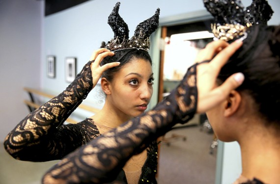 "Richmond Ballet dancer Elena Bello tries on the costume for Carabosse, the wicked fairy from the famous ballet, ""The Sleeping Beauty."" Traditionally the role is given to a male dancer and portrayed as an ugly witch — but this version is going with a fiercely beautiful villain."