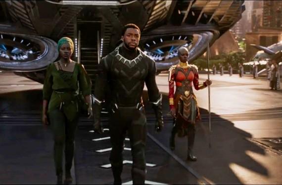 Lupita Nyong'o as Nakia, Chadwick Boseman as T'Challa, or the Black Panther, king of the fictional land, Wakanda, and Danai Gurira as Okoye in the first major superhero movie to be led by a black ensemble cast.