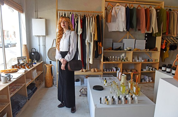 Katherine Manson, a fashion merchandising student at VCU who earned a prestigious scholarship last year, stands at Na Nin at 101 S. Addison St.