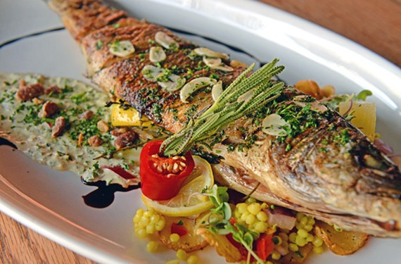 Pik Nik serves up dishes like a whole branzino with citrus Israeli couscous salad, avocado creme fraiche and candied walnuts.