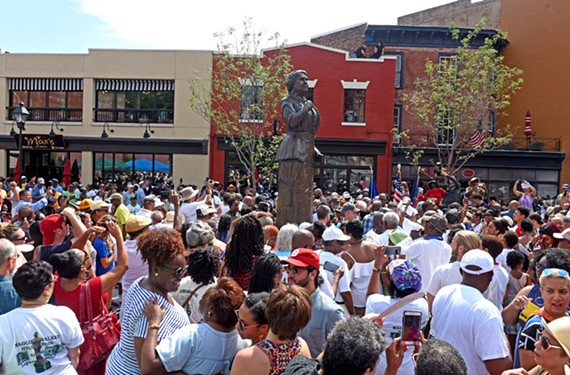 A festive crowd gathered all day for the unveiling of the statue of Maggie Walker, the first Richmond woman to be honored among the city's outdoor monuments.