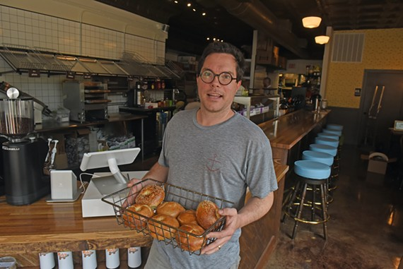 """The line was out the door,"" Mathews says of the quiet, surprise open hours he held last week. ""We sold out of 300 bagels in about an hour and a half."""