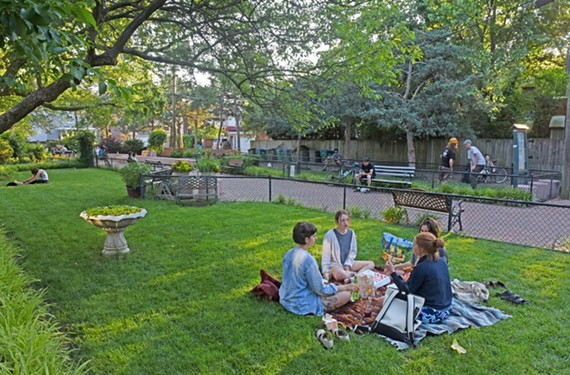 People enjoy Scuffletown Park on a recent weeknight in the Fan. After concerns were raised about over-regulating the urban oasis, the city says the main goal is for residents to respect the parks.
