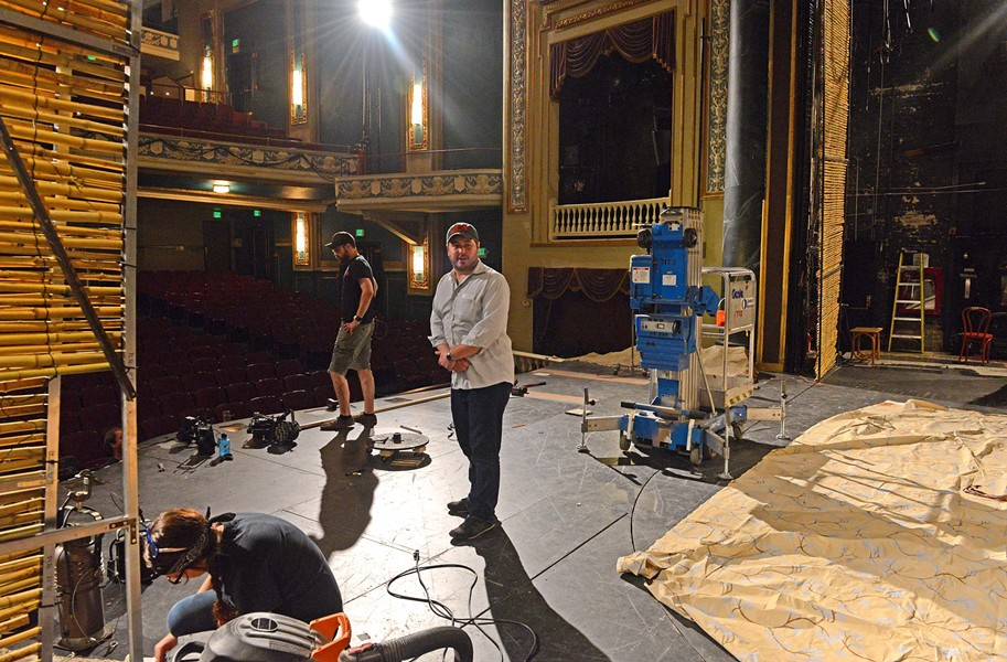 """South Pacific"" director Chase Kniffen works with the production crew while the set starts taking shape. The 30-year-old had his first big theater experience as a 13-year-old on Broadway, where he played John in ""Peter Pan."" - SCOTT ELMQUIST"