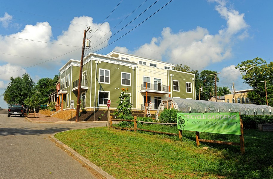 The recently completed apartment building at 1001 Bainbridge St., a 12-unit project developed by Urban Development Associates, is across the street from the urban farm Tricycle Gardens. - SCOTT ELMQUIST