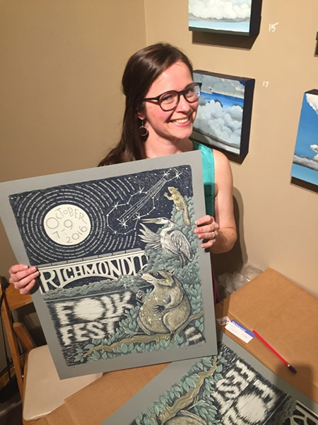 Artist Katie McBride with her poster at the annual unveiling on Sept. 7.