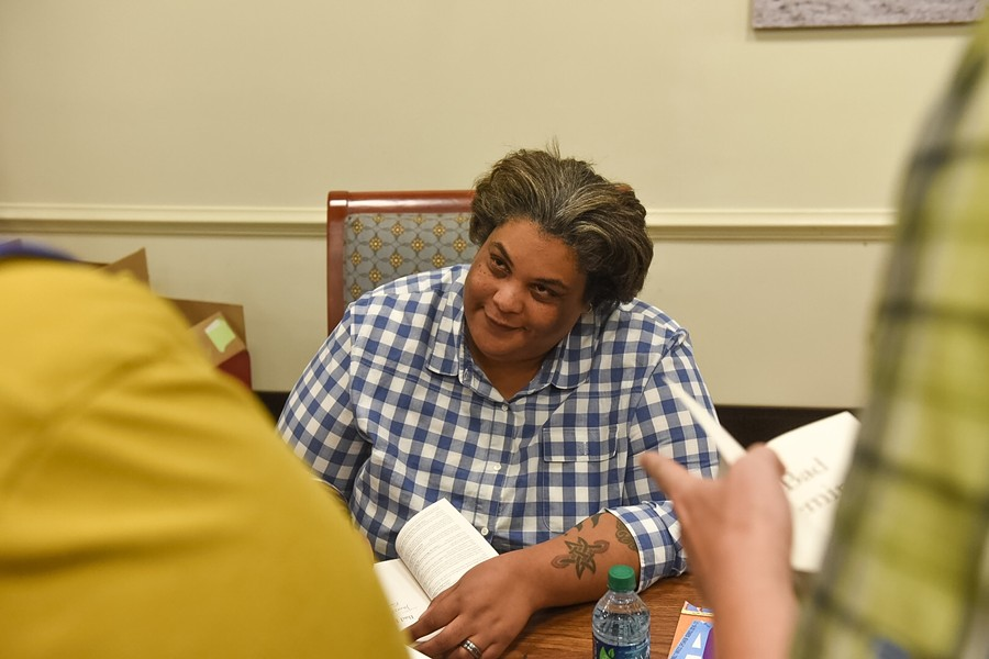Author Roxane Gay signs books following a presentation at the University of Richmond on Wednesday night. - SCOTT ELMQUIST