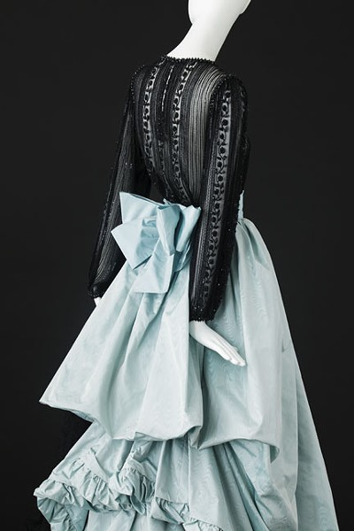 A blue silk taffeta gown with train and white silk taffeta flounces, trimmed with black braiding from the spring-summer 1981 haute couture collection of Yves Saint Laurent. - ALEXANDRE GUIRKINGER