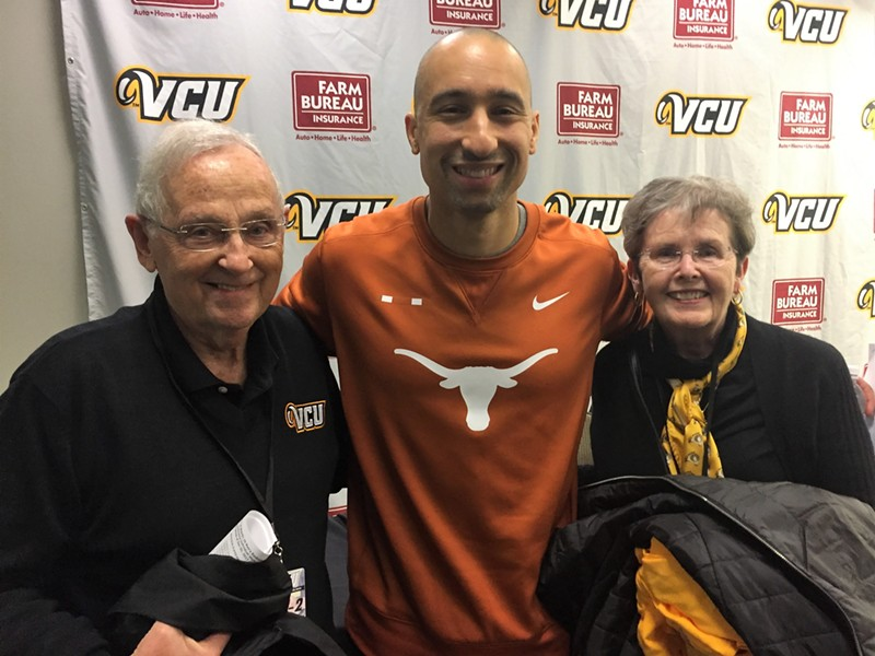 Former President of VCU, Eugene Trani and his wife, Lois, pose with former basketball coach Shaka Smart after Tuesday's highly touted game. - F.T. REA