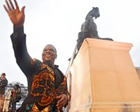 """New York-based artist Kehinde Wiley waves at the """"Rumors of War"""" public unveiling in front of the VMFA on Dec. 10."""