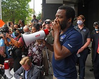 Mayor Levar Stoney apologized and stood before an angry, shouting crowd demanding accountability in front of City Hall on Tuesday, June 2.