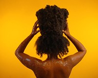 """Artist Stephanie J. Woods' """"the wait of it"""" is a five-channel installation and photography series featuring """"moving audio photographs"""" and nine years of detangled hair formed into a loosely woven vessel."""