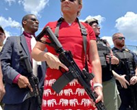 July 4: State Sen. Amanda Chase, GOP hopeful for Virginia governor, was a   featured speaker at a 2nd Amendment Rally, Virginia State Capitol. Photographer's note: When I saw Sen. Chase step out of the black SUV and strap on an assault rifle, I knew I was witnessing an event unlike any other in my 30 years as a photographer. Surrounded by militia also carrying assault rifles, she walked to the Bank Street entrance of the Capitol and started addressing the crowd. The scene was surreal. A candidate for governor stood before the press in a public space calling for gun rights in a state where 1,000 Virginians die from gun violence every year. A state that carries the legacy of the massacres at Virginia Tech and more recently, Virginia Beach.