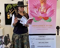 Author Wendi Cherry reads from her book at the Black Book Expo, A Conscious Literary Festival.