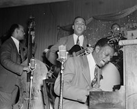 The King Cole Trio performs at the Romany Room in 1941. During the engagement, Cole penned and recorded a musical birth announcement in honor of the proprietor's newborn son.